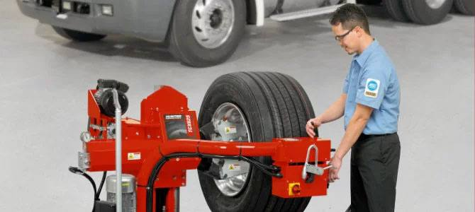 mechanic changes heavy-duty truck tire